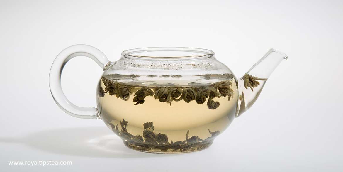 jasmine pearls green tea in a glass teapot
