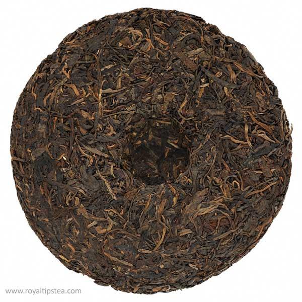 aged raw sheng puerh tea cake